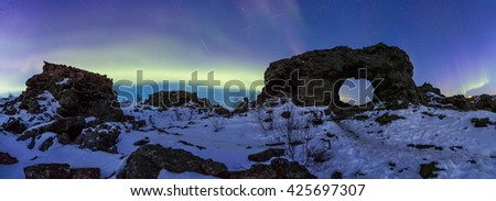 Northern Lights above Dimmuborgir in Iceland - stock photo