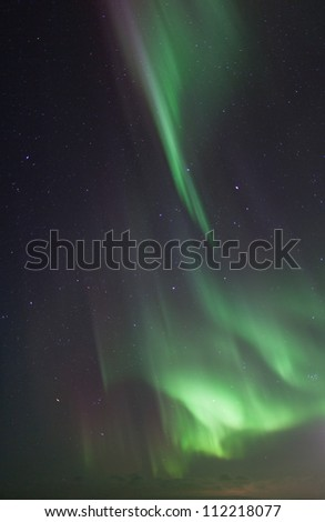 Northern lights over lake Myvatn in Iceland - stock photo