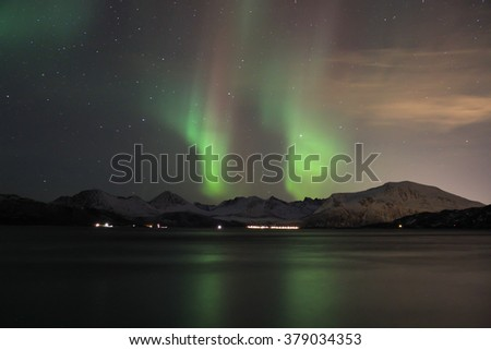 Northern lights reflected in seawater. Tromso, Norway. - stock photo