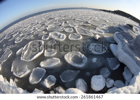 Northern seascape with blocks of ice ans ships - stock photo