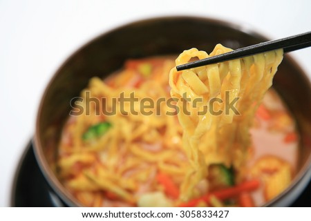 Northern Thai cuisine, Curried Noodle Soup with coconut milk (Khao soi). - stock photo