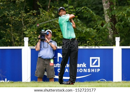 NORTON, MA-SEP 1: Tiger Woods tees off the fifth hole during the third round at the Deutsche Bank Championship at TPC Boston on September 1, 2013 in Norton, Massachusetts.  - stock photo