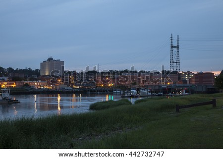 NORWALK, CONNECTICUT - JULY 3: Evening and Maritime center view from park near bridge in Norwalk in July 3, 2015 in Norwalk, Connecticut. - stock photo