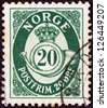 NORWAY - CIRCA 1937: A stamp printed in Norway shows crown, post horn and value, circa 1937. - stock photo