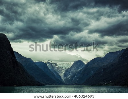 Norway fjord severe landscape. Dramatic dark colors. - stock photo