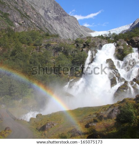 Norway, Jostedalsbreen National Park. Famous waterfall originating from Briksdalsbreen glacier in Briksdalen valley. Square composition. - stock photo