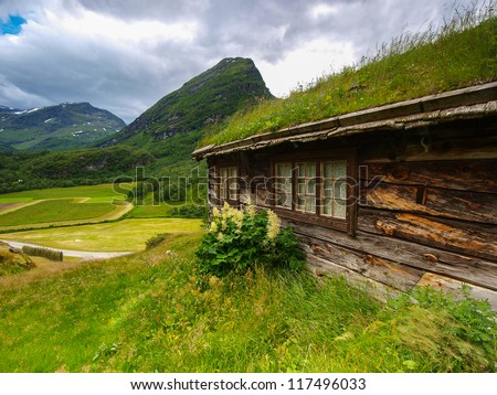Norway landscape. Building with grass on the roof - stock photo