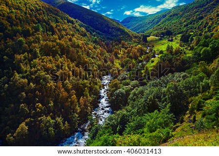 Norway landscape with mountain river and autumn forest - stock photo