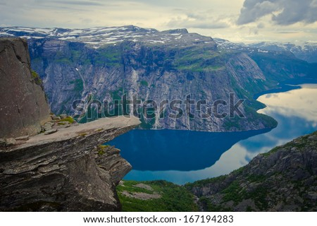 Norway Mountain Trolltunga Odda Fjord Norge Hiking Trail Waterfall The Troll Tongue Norge Scandinavia Nature Travel National Geographic Oslo Fjord  - stock photo