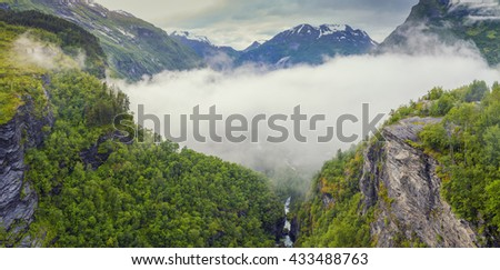 Norway Mountains And Fjord View - Clouds Over Geirangerfjord, Stranda, Norway - stock photo