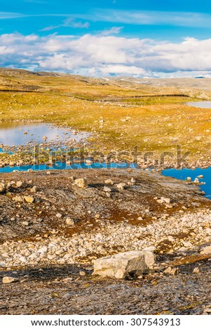 Norway Nature Landscape Panorama. Norwegian Mountains Under Sunny Blue Sky - stock photo