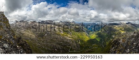 Norway. The view from the observation deck Dalsnibba. View of the fjord Geiranger, mountain peaks, meadows, mountain roads. - stock photo