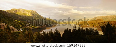Norwegian lake or fjord (Eikefjorden) at evening, mountains in background.  Panoramic composition of 5 images. - stock photo