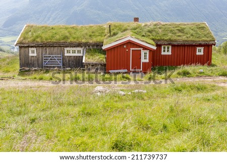 Norwegian typical grass roof country house - stock photo