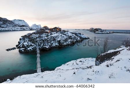 Norwegian winter panorama. Polar night. House on the island. - stock photo