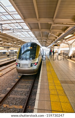 nose end view of a modern high speed commuter train in the station - stock photo