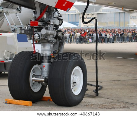Nosewheel assembly of a very large passenger airplane - stock photo