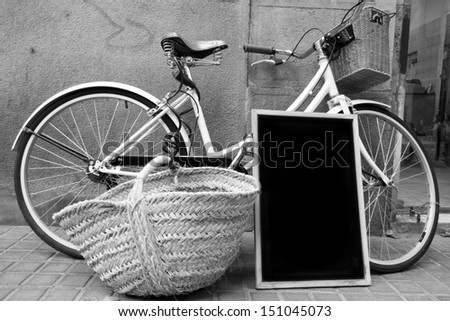 Nostalgia of the past when the board, bicycle, and wicker replaced the touch screen, SUV and plastic. - stock photo