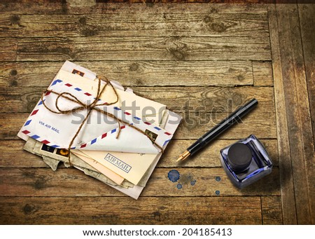 Nostalgic airmail letters with ink bottle and fountain pen - stock photo