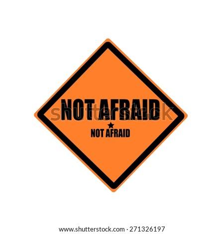 Not afraid black stamp text on orange background - stock photo