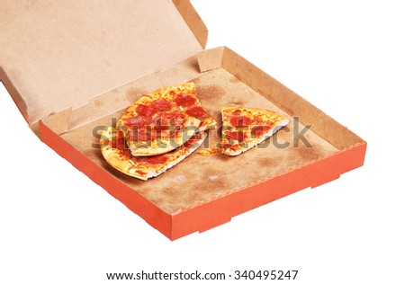 not fresh Slices of Pepperoni Pizza in box isolated on white background - stock photo
