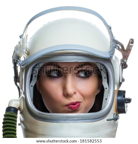 Not impressed young woman wearing space helmet isolated on white background. Emotional concept - stock photo