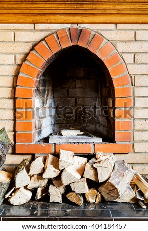 not kindled brick fireplace and wood logs indoor - stock photo