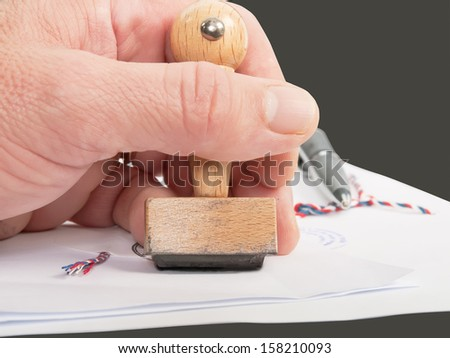 notary public in office verify documents - stock photo