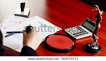 Notary public stamping power of attorney. Notary public accessories - stock photo