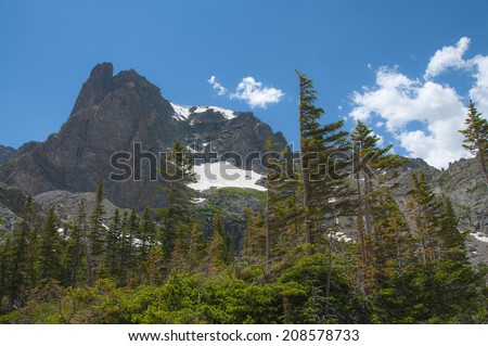 Notchtop Mountain as seen from lake Helene Trail - stock photo