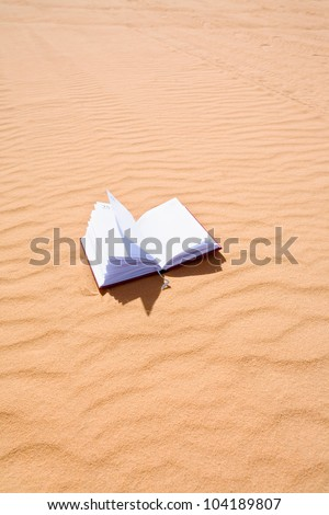 note book on sand dune of Wadi Rum desert, Jordan - stock photo