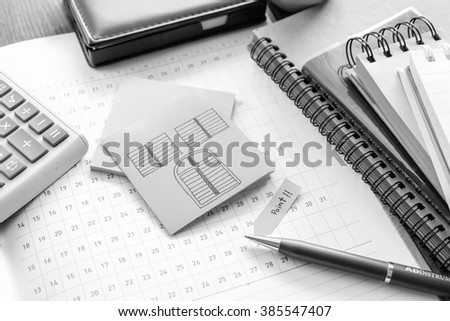 note book on wooden table with black and white color concept - stock photo