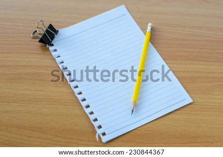 Note book paper with pencil - stock photo