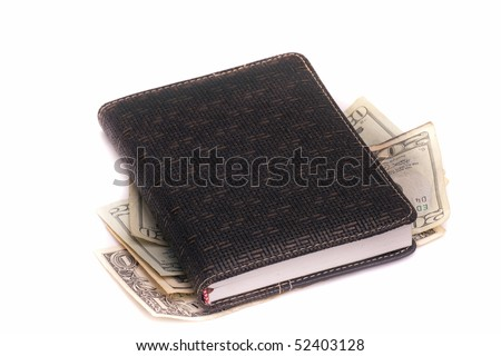 note-book with the money on a white background - stock photo