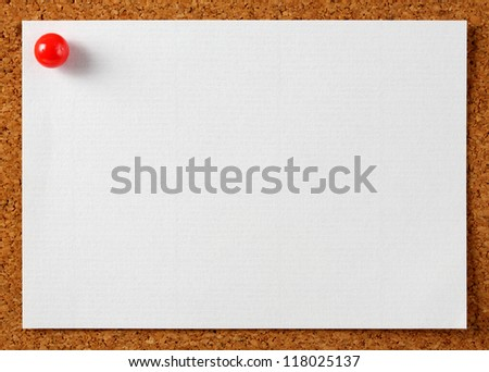 Note memo paper with red pin on cork board - stock photo