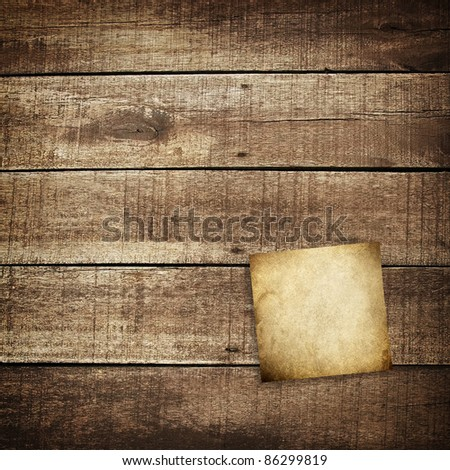 note on wood plank - stock photo