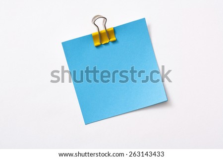 note paper and clip isolated on white background - stock photo