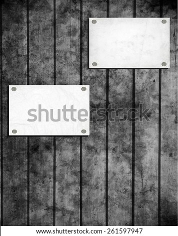 Note paper and paper clip on wooden background - stock photo
