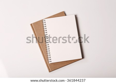 Note paper book white and brown on white background - stock photo