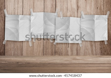 note paper on wooden background and copy space for your text creativity ideas concept - stock photo