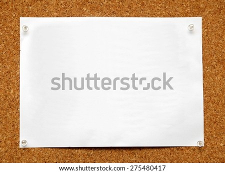 note paper pined on brown cork board background - stock photo