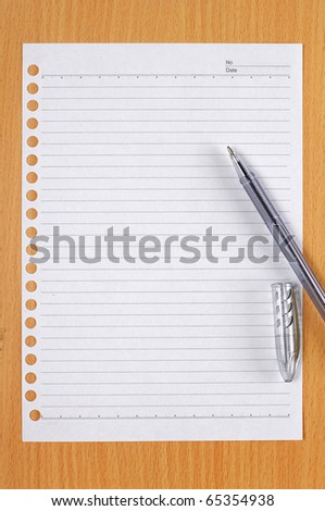 note paper with pen on the wooden table - stock photo