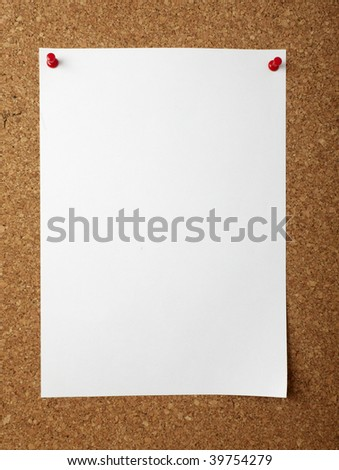 note paper with push pins on cork board - stock photo