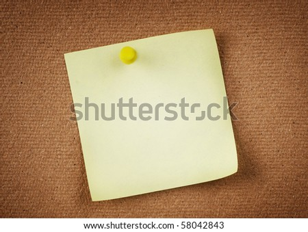 Note paper with push pins on notice board - stock photo