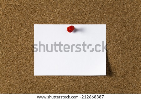 Note paper with red pin on the cork board - stock photo