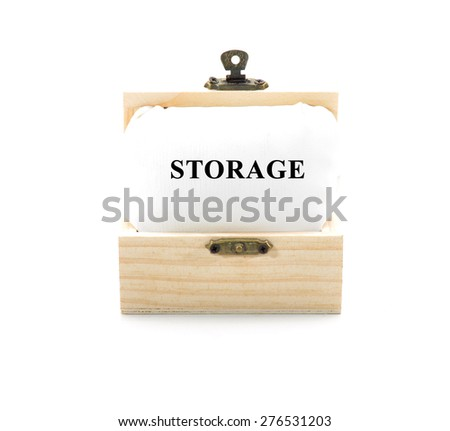 "Note with word ""STORAGE"" in wooden chest isolated on white background - stock photo"