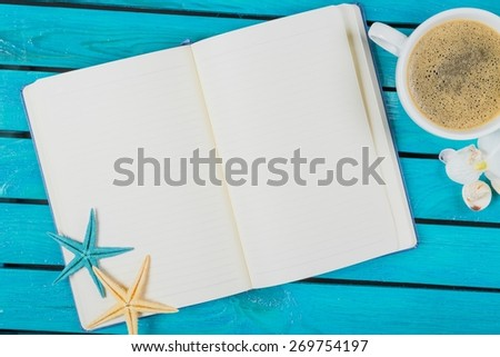 Note. Workspace with coffee cup, instant photos, note paper and notebook on old wooden table - stock photo