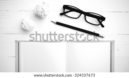 notebook and crumpled paper over white background black and white tone color style - stock photo