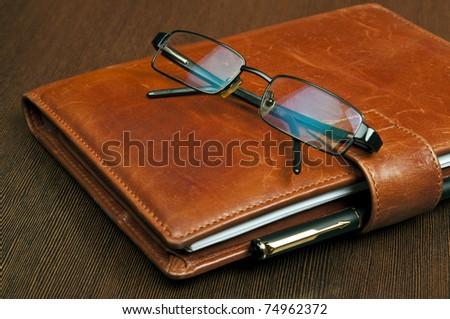 Notebook and luxury black pen - stock photo