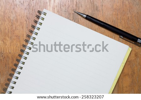 Notebook and pen on desk  - stock photo